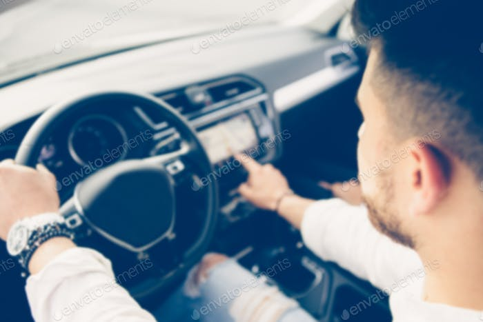 Young man is using the automotive navigation system