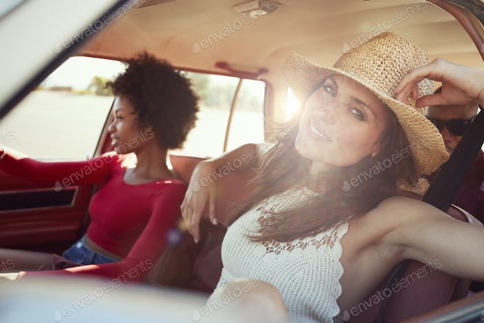 Portrait Of Friends Relaxing In Car During Road Trip