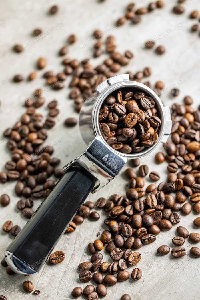 Roasted coffee beans in coffee filter holder