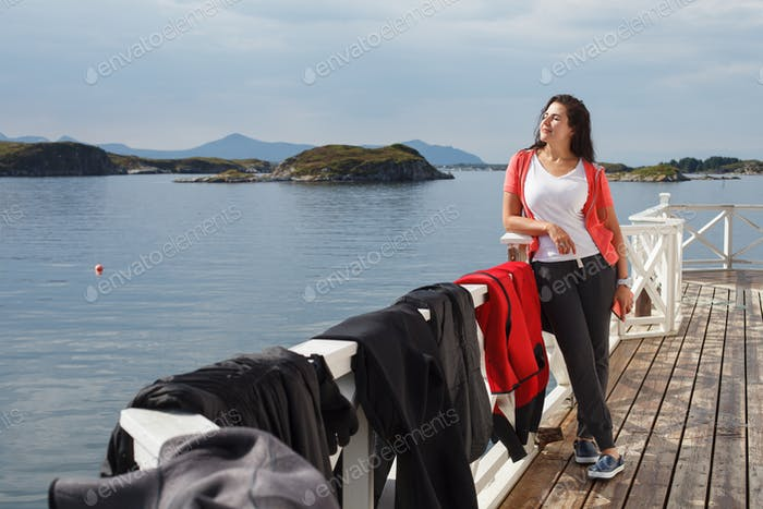 Young woman against view on norwegian fjords