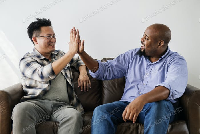 Men joining hands together