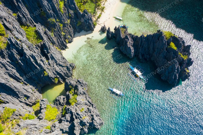 El Nido, Palawan, Philippines, aerial view of boats and cliffs rocky mountains scenery at Secret