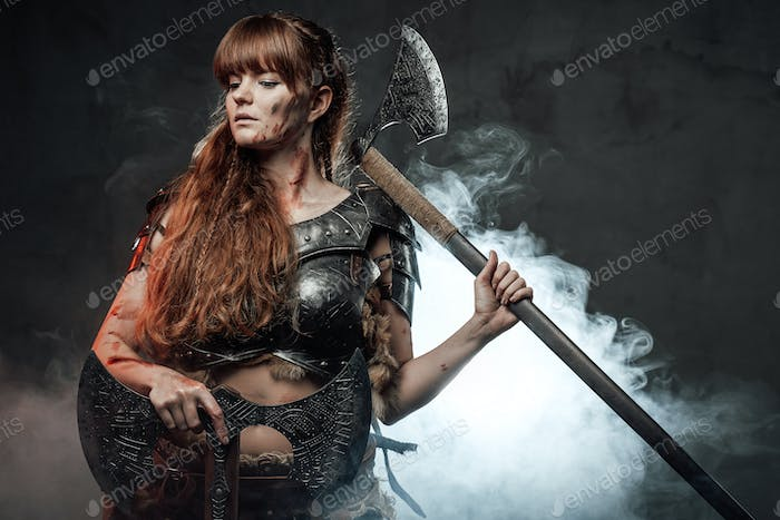Scandinavian female conqueror armed with axes