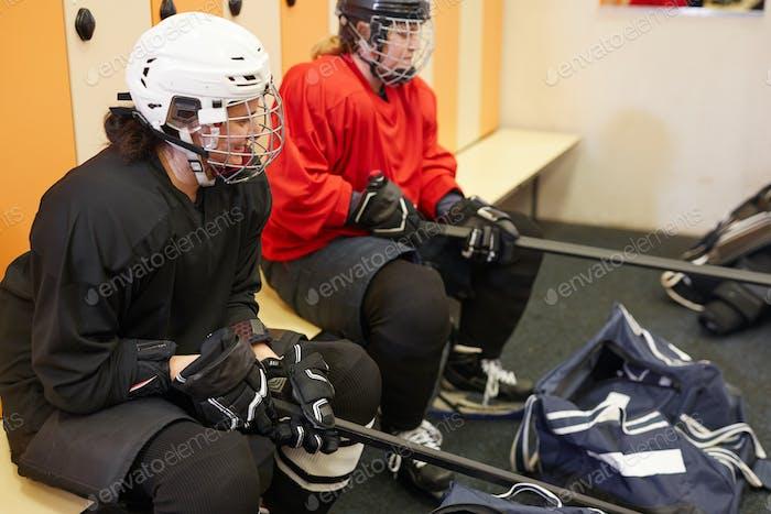 Hockey Players Getting Ready in Locker Room