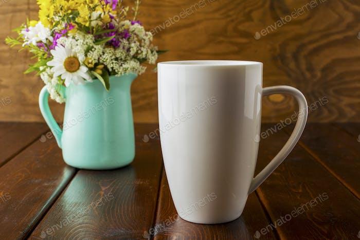 Coffee mug mockup with wild flowers