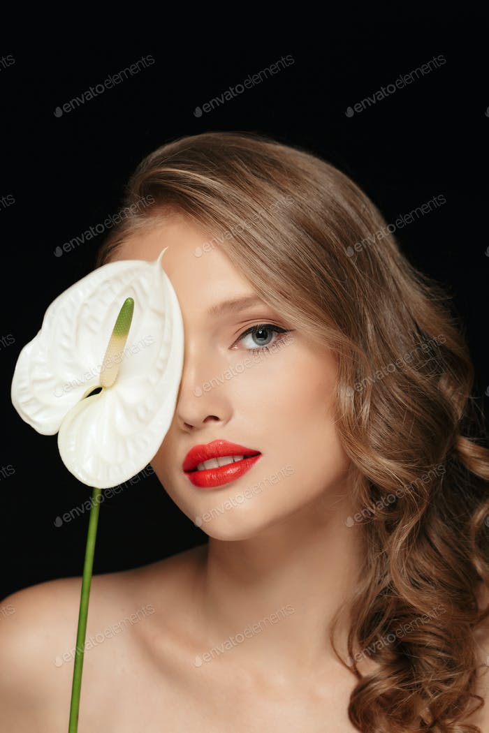 Portrait of young beautiful woman with wavy hair and red lips co