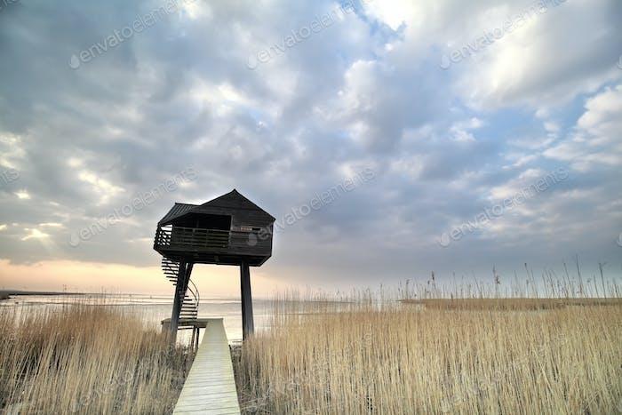 wooden observation tower over sky