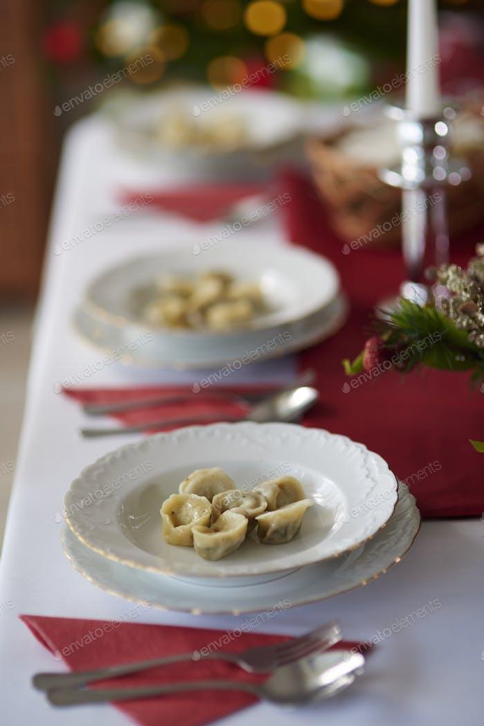 Many plates on Christmas table