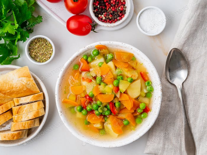 Vegetable soup, bright spring vegetarian dish.