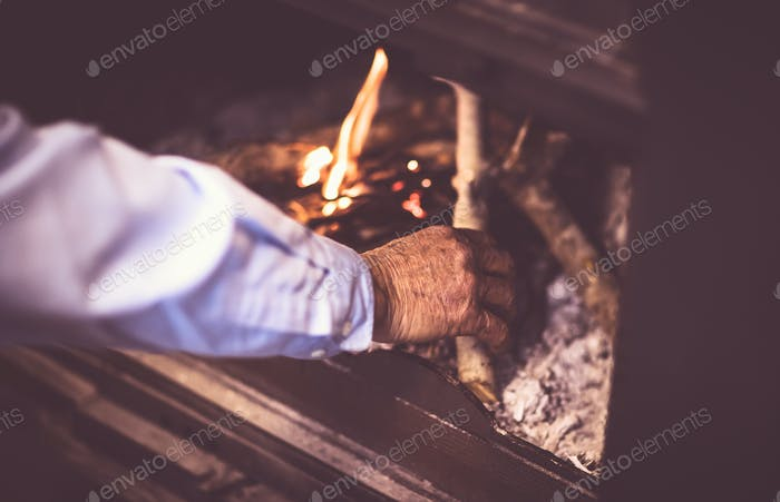 Man kindle a fire in the fireplace