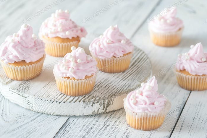 Many pink cream homemade cupcakes