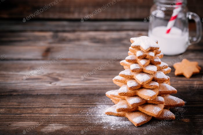 Homemade baked Christmas gingerbread tree with icing sugar