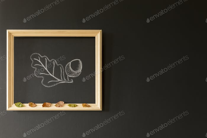 Chalkboard wall with acorn drawing