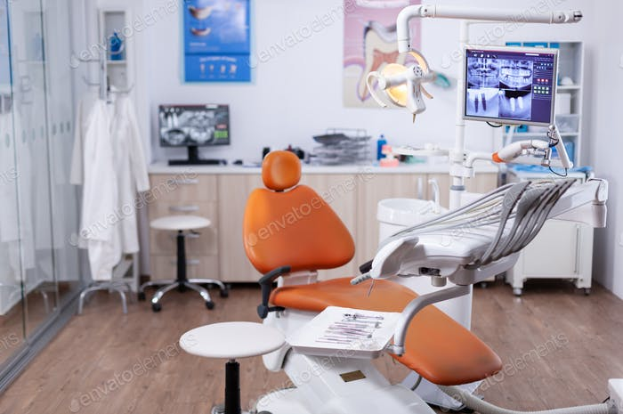 Dentist's office interior with modern chair and special dentisd equipment