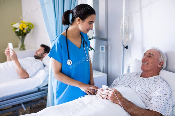 Female doctor interacting with male senior patient