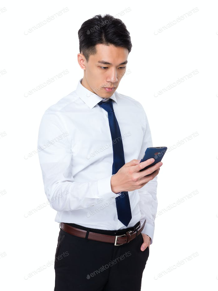 Young businessman read the message on cellphone