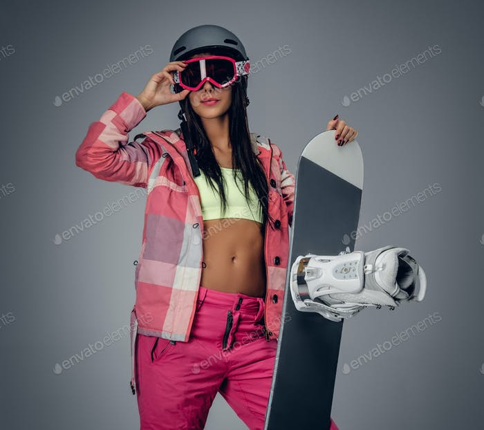 Portrait of active female in a pink ski costume.
