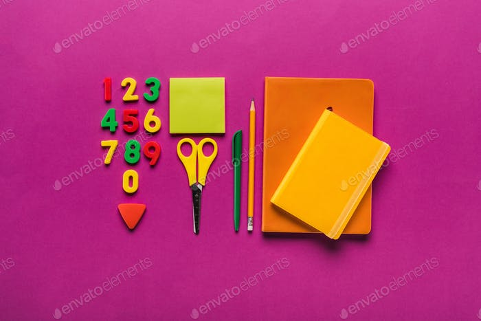 composition of colorful school supplies with plastic numbers