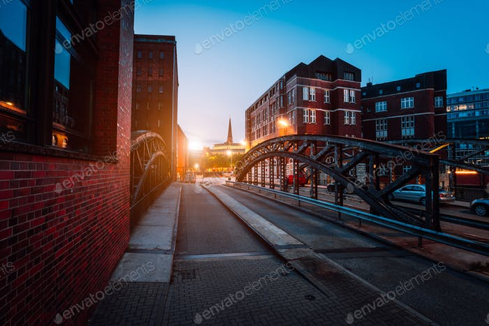 Empty Poggenmuehlen Bridge at twilight. Hamburg, Germany. illuminated buildings and last sunrays