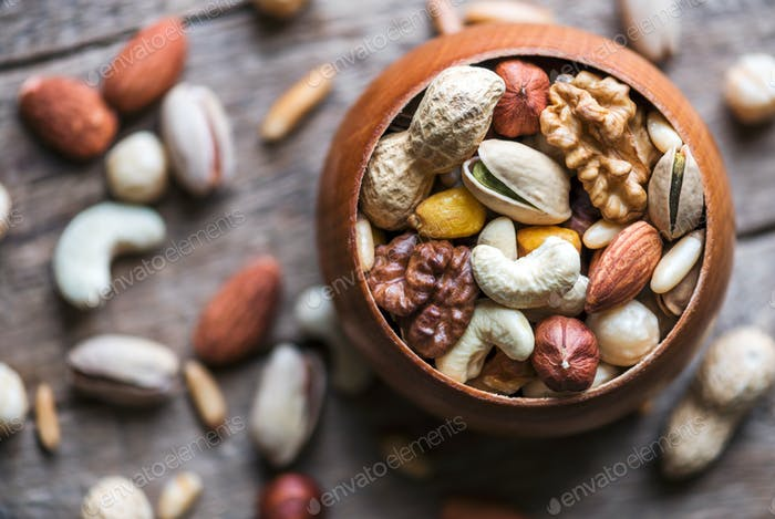 Mixed nuts in wooden bowl
