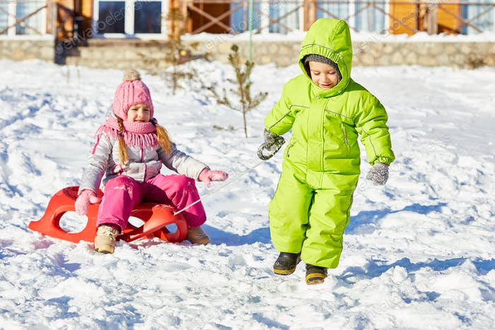 Kids sledding on winter day