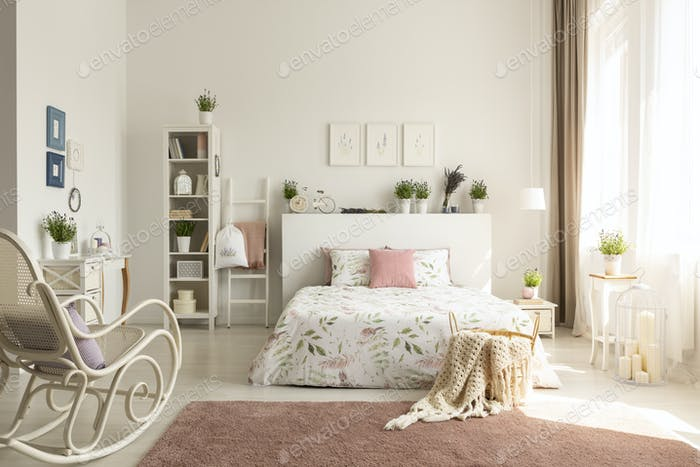 White bedroom interior with dirty pink carpet, rocking chair, wi