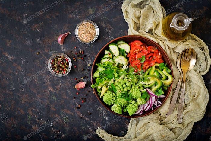 Vegan salad of fresh vegetables and cabbage romanesko