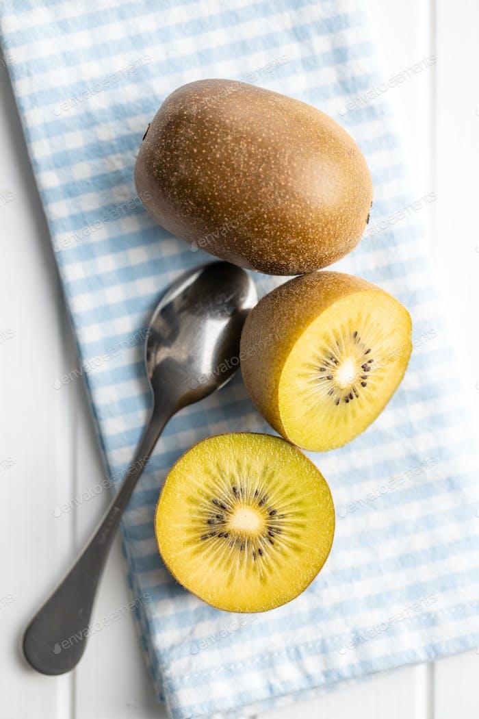 Halved ripe yellow kiwi fruit.