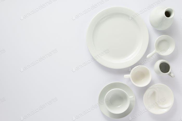 empty set of dishes on white  background