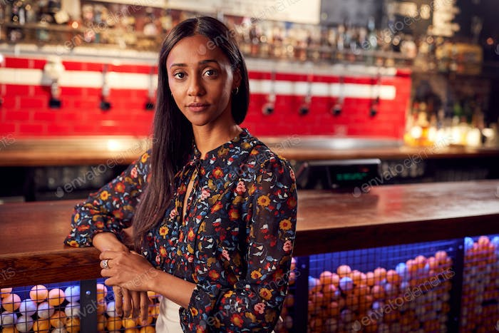 Portrait Of Female Bar Owner Standing By Counter