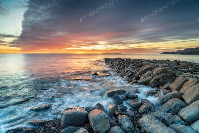 Sunset over Clavell Pier in Dorset