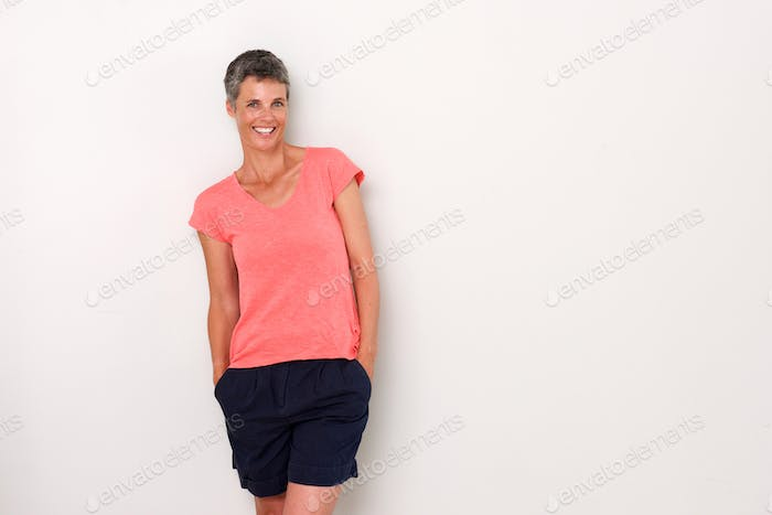 attractive woman laughing against white wall