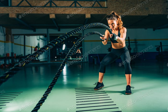 Cross training. Rope swing exercise