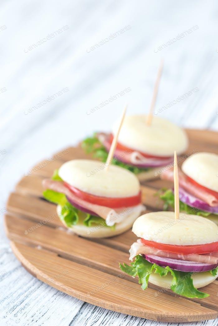 Mini cheese and prosciutto sandwiches