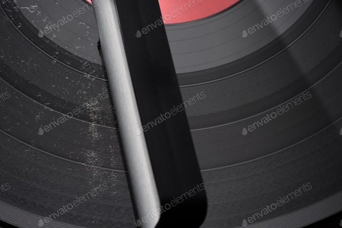 Carbon fiber brush with dust and dirt on vinyl record.