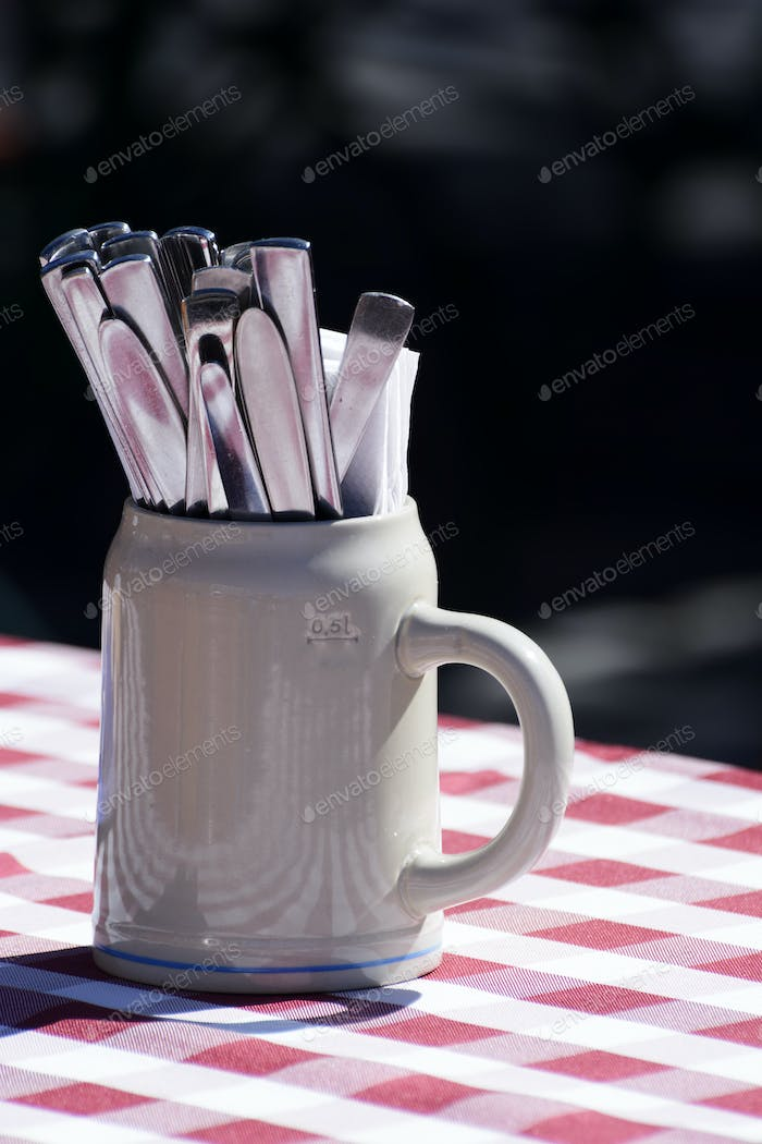 Clay Jug and Silverware