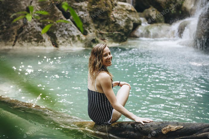 Beautidul woman at a waterfall