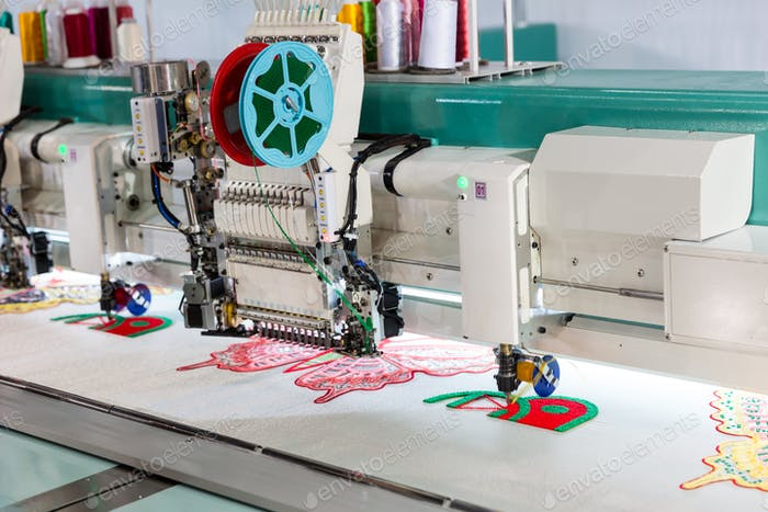 Sewing machine on textile fabric, nobody
