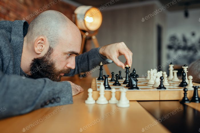 Chess player playing black figures, queen move