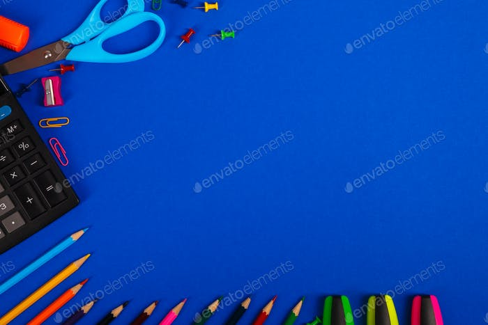 School or office stationery on blue background.