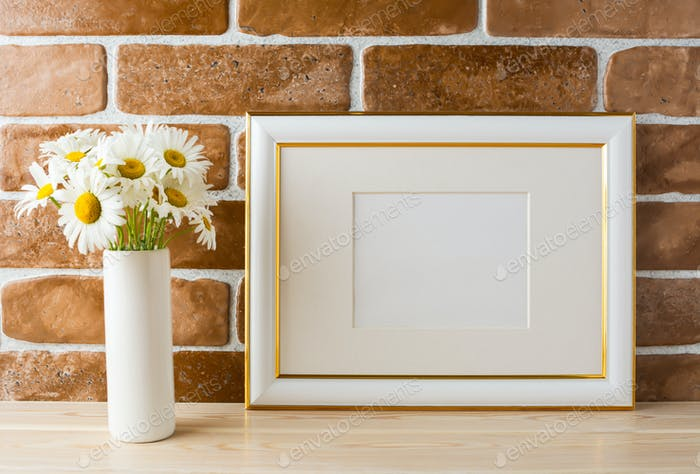 Gold decorated landscape frame mockup with daisy bouquet in vase