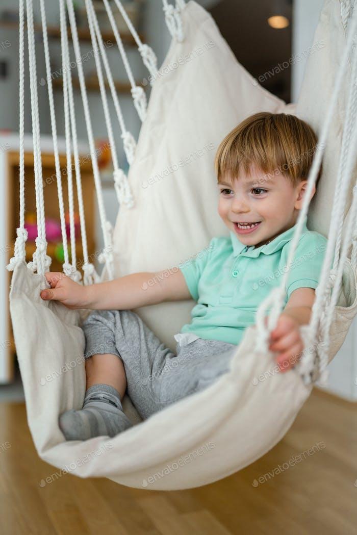 Portrait of happy child toddler boy having fun, smiling
