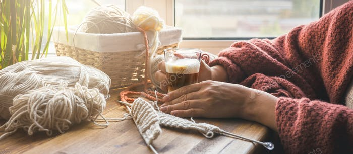 Knitting from threads at home. Hobby, relaxation, meditation, mental health during the quarantine