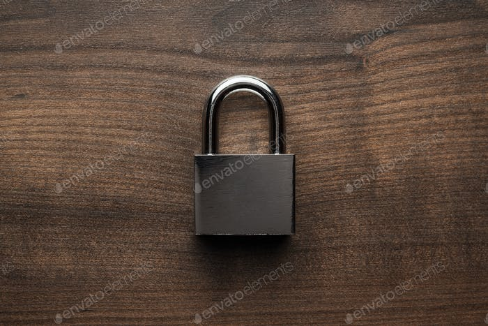 Check-Lock On The Brown Wooden Table