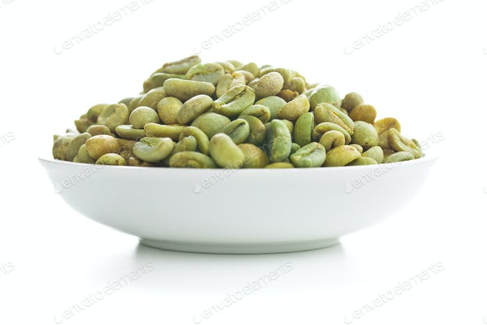 unroasted coffee beans in bowl