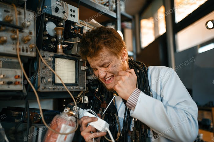 Crazy scientist works with electricity in lab