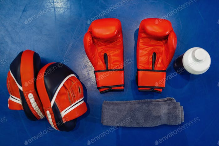 Boxing gloves, pads and equipment on ring, nobody