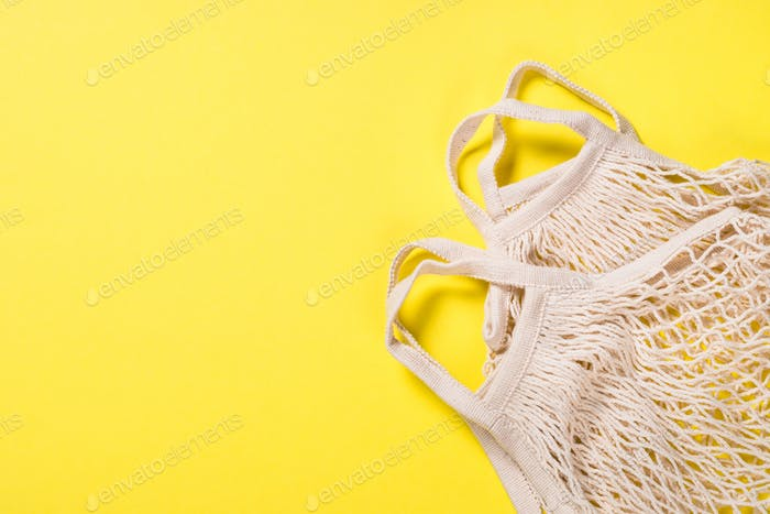 Mesh bag for zero waste shopping on color background