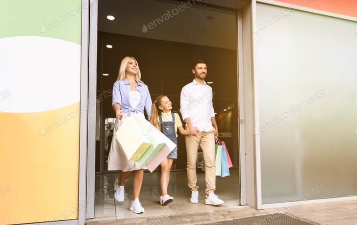 Family Leaving Hypermarket Carrying Colorful Shopper Bags