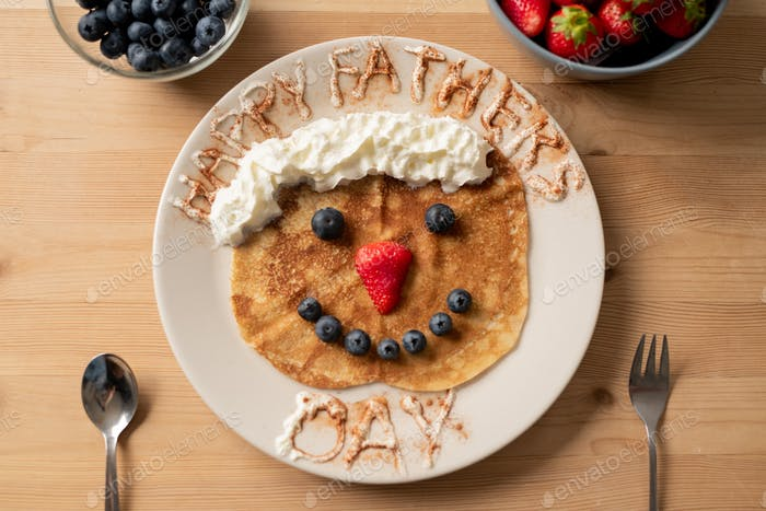 Sweet crepe decorated with berries for daddy